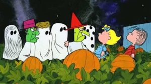 Linus, Sally, and the rest of the Peanuts gang in the pumpkin patch