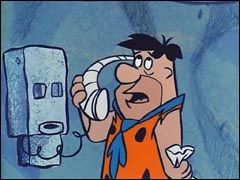 Fred Flintstone on phone