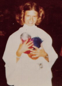 Suzanne as Princess Leia, holding tribbles